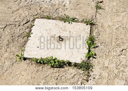 cloeseup of a square hatch on a concrete background