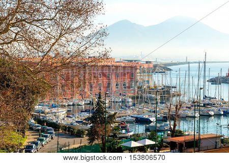NAPLES, ITALY - January 23, 2016 Street view of Naples harbor with boats. January 23, 2016, Naples, Italy