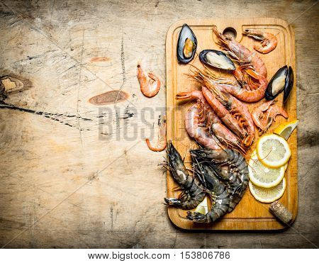 Fresh Seafood. Cutting Board With Shrimp, Shellfish And Lemon.