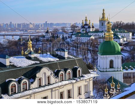 Panoramic view on Kiev Pechersk Lavra Christian Monastery in winter. The Dnieper River, Church of the Nativity of the Virgin Mary, Bell towers of Near and Far Caves. Ukrainian Baroque, 18th century