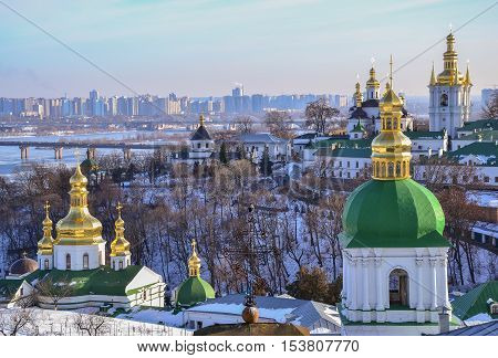Panoramic view of Kiev Pechersk Lavra Monastery in winter. The Dnieper River, Church of the Exaltation of the Cross, Church of the Nativity of the Virgin Mary, Bell towers of Near and Far Caves. Ukrainian Baroque, 18th century