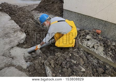 Plumber At Construction Site Repair Sewerage Tube