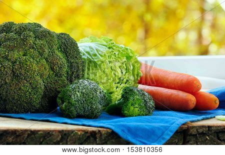 Variety Of Fresh Vegatables Cabbage, Chinese Cabbage And Brocolli On Wooden Table .bokeh Background.