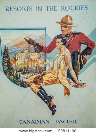 Alberta Canada - October 19 2007 : old poster of Canadian Pacific with Canadian Mounted Policelady and resort Banff Hotel