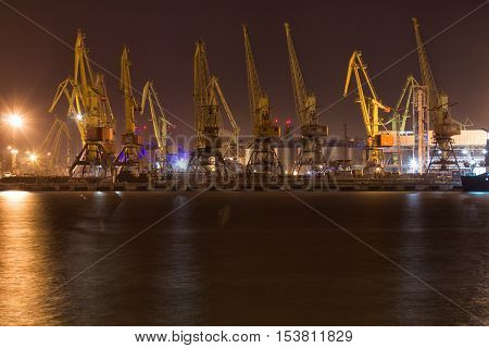 Cargo cranes and loading / discharging terminal of port Odessa Ukraine. Night view picture