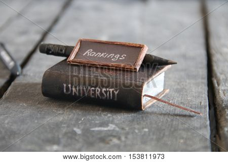University rankings concept. Inscription and book, vintage style.