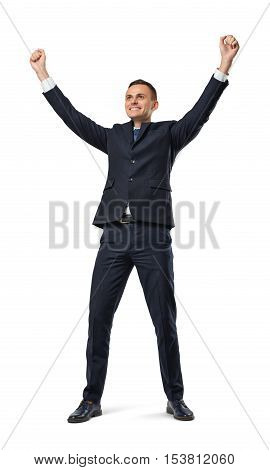 A happy businessman in a celebrating pose with his hands in the air isolated on the white background. Business and management. Succesful people. Poses and gestures.