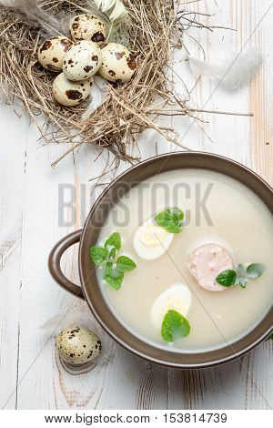 Sour soup spiced with marjoram on old wooden table