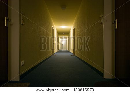 Dimly Light Corridor Hallway Apartment Complex Perspective Exit Lit Eerie Yellow Architecture