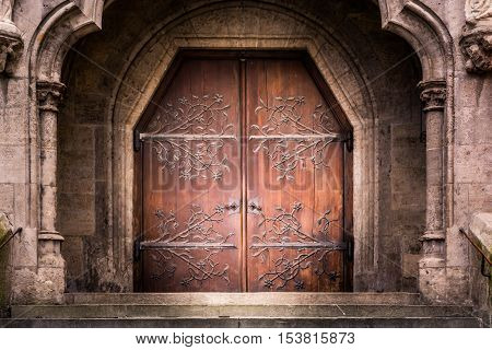 Old Reinforced Medieval Middle Ages Entrance Wooden Iron Doors Stone Castle Church Cathedral Staircase Dramatic Shadow Mysterious poster