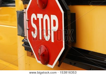 Closeup view of the stop sign on a school bus.