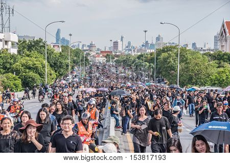 Bangkok Thailand - October 22 2016 : Thai people come for singing the anthem of His Majesty King Bhumibol at Pinkhao bridge near the Royal Palace to pay respect for the king in Bangkok Thailand.
