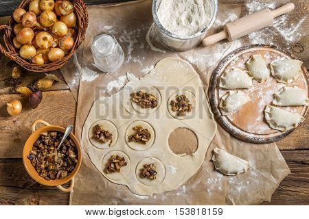 Ingredients for dumplings with mushrooms on old wooden table