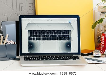 PARIS FRANCE - OCT 28 2016: Apple Computers website on new MacBook Pro Retina with OLED touch bar in a geek creative room showcasing new professional laptop - detail of