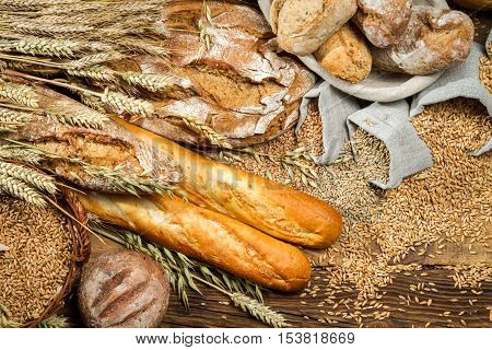 Various Kinds Of Whole Wheat Bread On Old Wooden Table
