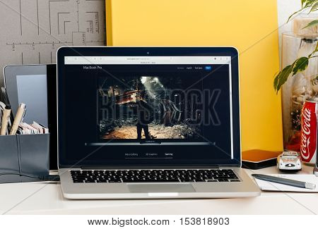PARIS FRANCE - OCT 28 2016: Apple Computers website on new MacBook Pro Retina with OLED touch bar in a geek creative room showcasing new professional laptop - detail of game runnning on the new laptop