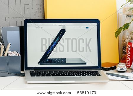PARIS FRANCE - OCT 28 2016: Apple Computers website on new MacBook Pro Retina with OLED touch bar in a geek creative room showcasing new professional laptop - side view of the new 15 inch laptop in space gray