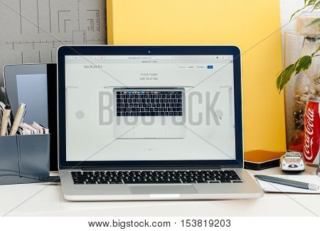 PARIS FRANCE - OCT 28 2016: Apple Computers website on new MacBook Pro Retina with OLED touch bar in a geek creative room showcasing new professional laptop - 13 inch model with touch bar seen from above
