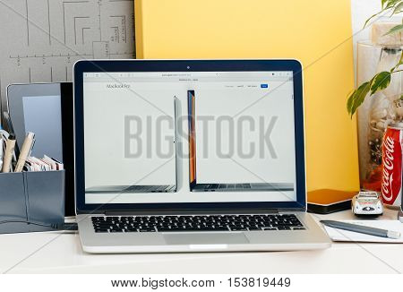 PARIS FRANCE - OCT 28 2016: Apple Computers website on new MacBook Pro Retina with OLED touch bar in a geek creative room showcasing new professional laptop - detail of 13 inch laptop and 15 inch laptop next to eachother