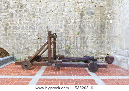 The interior of the Frankopan Castle at Kamplin square in Krk Croatia - Frankopanski Kastel part of the medieval city walls. View of the courtroom and wooden catapult inside the walls