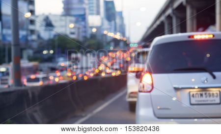 transportation vehicle and traffic concept - Blurred border bridge and Bokeh light of traffic jam evening in city life