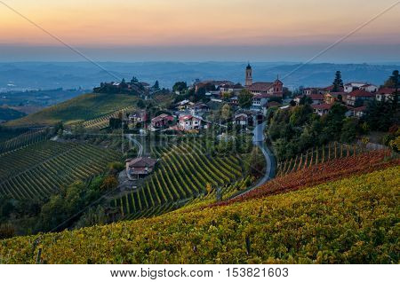 Le Langhe - Treiso and landscape in autumn colors at sunset