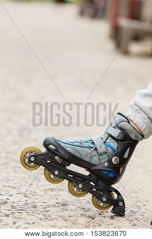 Closeup of woman girl with roller skates blades outdoor.