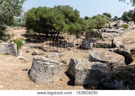 Cave di Cusa or Rocche di Cusa was an ancient stone quarry in Sicily. Its stone was used to construct the temples in the ancient Greek city Selinunte. The stone extraction was abandoned in 409 BC.