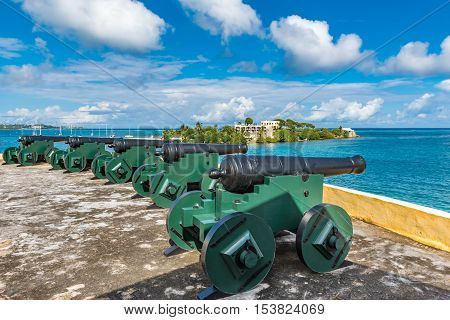 Vintage cannons facing the Caribbean ocean defending the bay