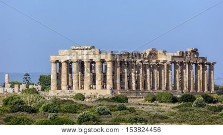 SELINUNTE ITALY - AUGUST 11 2016: Temple E (490-480 BC) in Selinunte thought to be dedicated to Hera considered to be one of the finest examples of Doric architecture in Sicily.