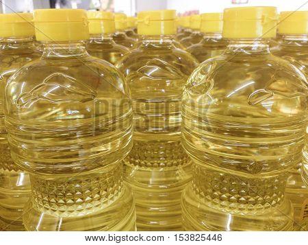 Sunflower oil in bottle pattern warehouse store. Food background