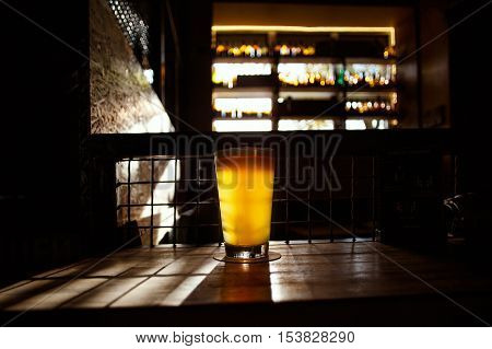 Craft Beer in Bar, Glass on table in authentic Pub