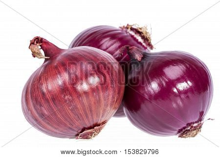 Group of red onions isolated on white background closeup