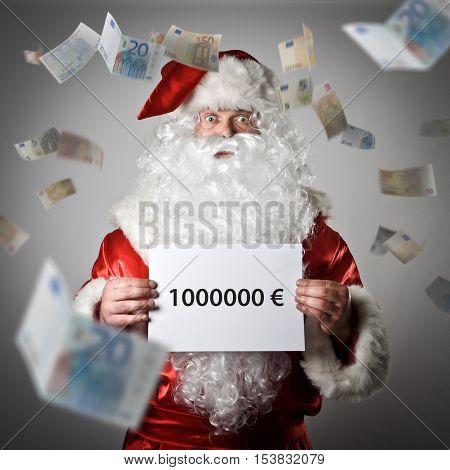 Santa Claus and falling Euro banknotes. One million Euro concept.