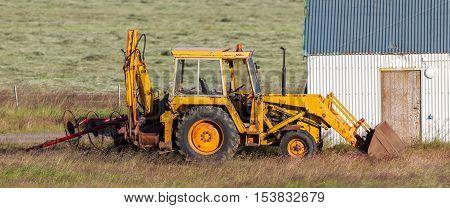 Yellow Digger At A Farm