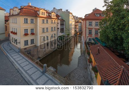 Kampa the part of Prague situated in Lesser Town and Devil´s stream (Certovka) the view taken from Charles bridge during the sunrise.