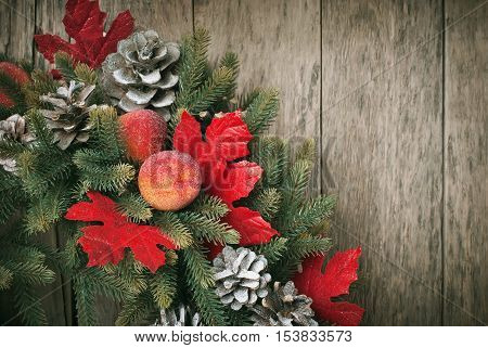 Christmas Card With Decorative Wreath On Wooden Background