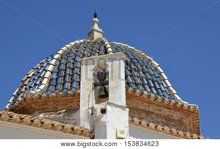 Roof dome and bell on the Monastery in Lliria near Valencia Spain
