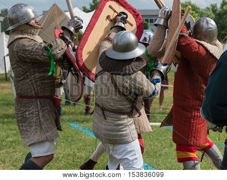 Knights in Battle with Silver Helmets and Armors: Medieval Event Reconstruction