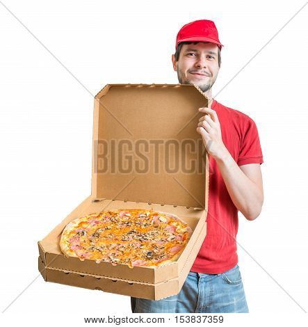Pizza delivery concept. Young guy is showing tasty pizza in box. Isolated on white background.