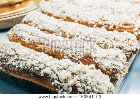 Eclair C Chocolate Glaze, Sprinkled With Peanuts. Six Delicious Eclairs , Pastry