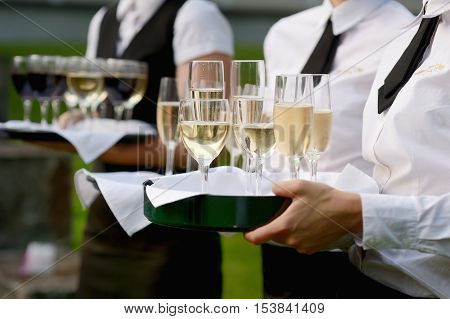 Waitress With Dish Of Champagne Glasses
