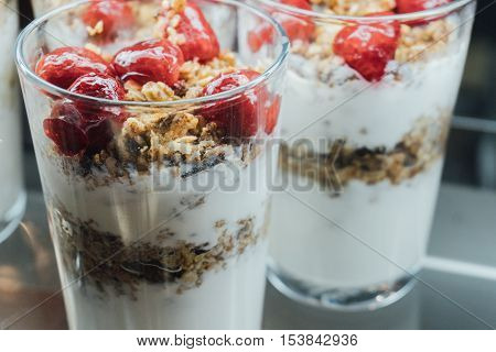 Granola With Yogurt In Glass Cups, Delicious Homemade Granola Using Glass. Fruit Granola