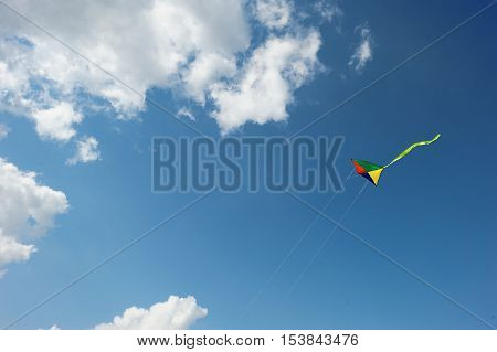 Rainbow Kite Flies In The Sky Among The Clouds