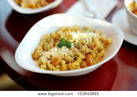 Delicious italian pasta on white plate in a restaurant
