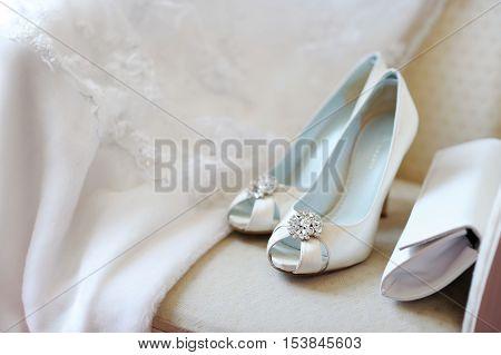 Elegant bridal shoes and a veil before wedding