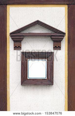 Empty info page square board on building facade