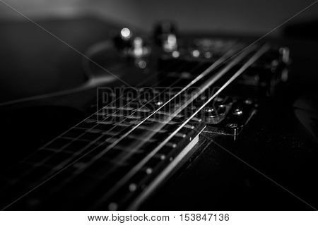 closeup shot of guitar string rattle, selective focus, Moment of extract music, black and white