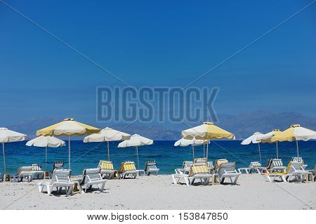 Chairs And Umbrellas On A Beautiful Sandy Beach