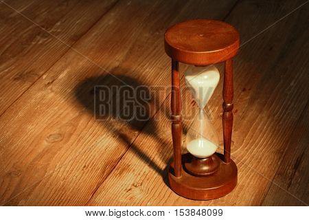A Hourglass close up in spot light